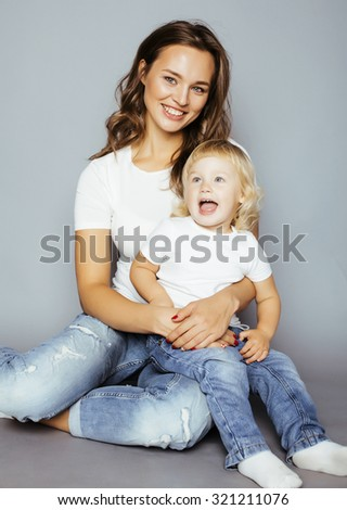 pretty real fashion mother with cute blond little daughter close up - stock photo