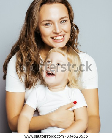 pretty real fashion mother with cute blond little daughter close up smiling cool - stock photo