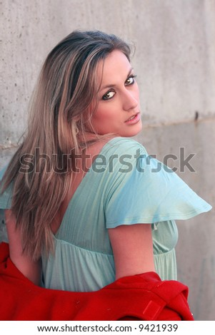 pretty red coat autumn looking to camera - stock photo