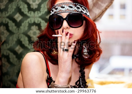pretty red hair woman portrait with cigarette - stock photo