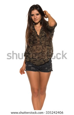 Pretty Romanian brunette in a camouflage blouse - stock photo