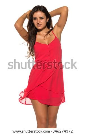 Pretty Romanian brunette in a short red dress - stock photo
