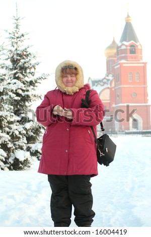pretty russian plump woman photophrapher in frost winter - stock photo