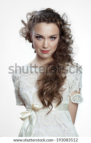 Pretty russian woman with curly hair on white background - stock photo