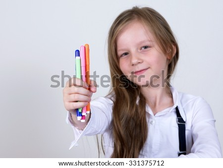 pretty school girl with colorful pencils