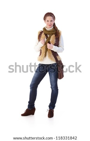 Pretty schoolgirl dressed up warm, smiling. - stock photo