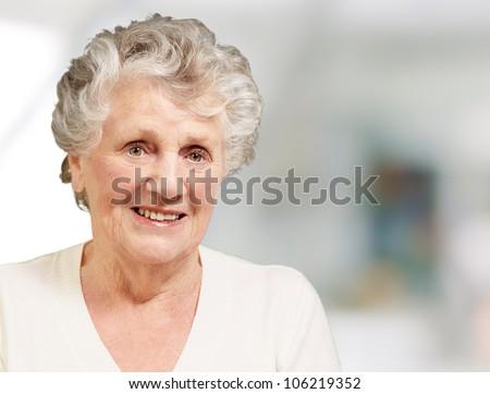 pretty senior woman smiling indoor - stock photo