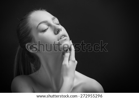 pretty sensual woman with bare shoulders on black background monochrome