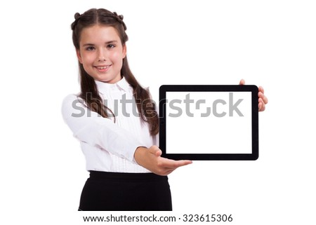 pretty serious schoolgirl in a business suit holds a horizontal plate in his hands and looking into the camera, Selective focus on the tablet - stock photo