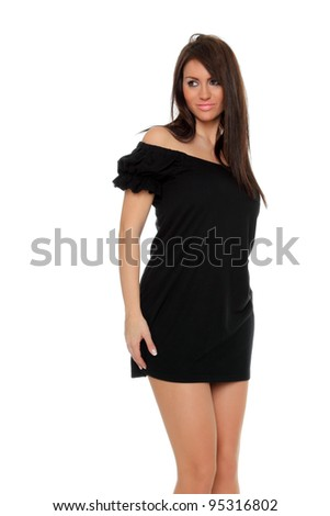 Pretty sexy girl  posing in a nice black dress isolated over white background