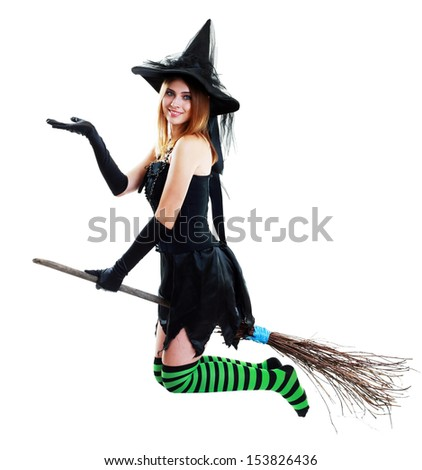 pretty sexy young brunette witch with a broom - stock photo