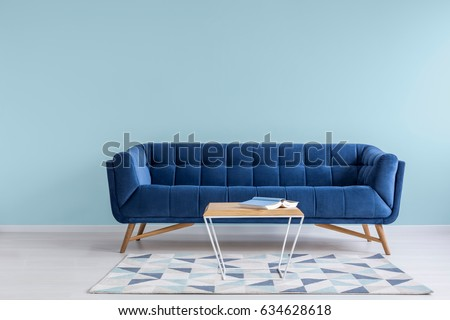 Pretty Simple Decor Of Living Room With Blue Sofa And Light Wall