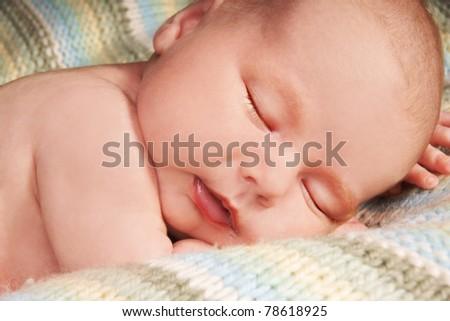 Pretty sleeping newborn baby boy, studio shot - stock photo
