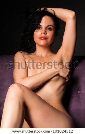 Pretty petite young nude brunette Stock Photo               RF com
