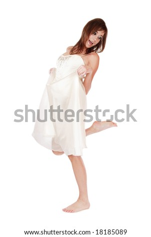 Pretty slim barefoot young girl in wedding dress hopping along