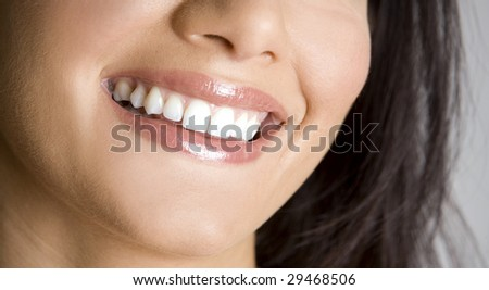 pretty smile of young caucasian brunette close up
