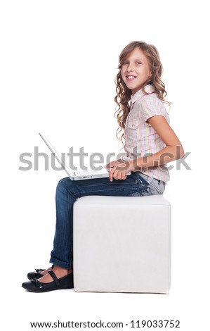 pretty smiley schoolgirl with laptop. isolated on white background - stock photo