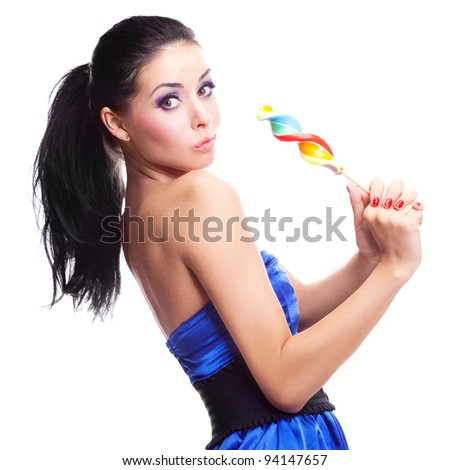 pretty smiling brunette girl with a lollipop in her hand, isolated against white background