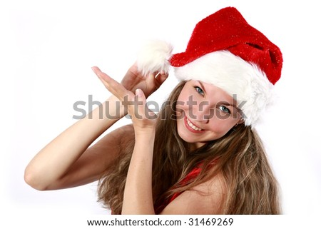Pretty smiling girl in a Christmas red dress and a hat isolated on white - stock photo