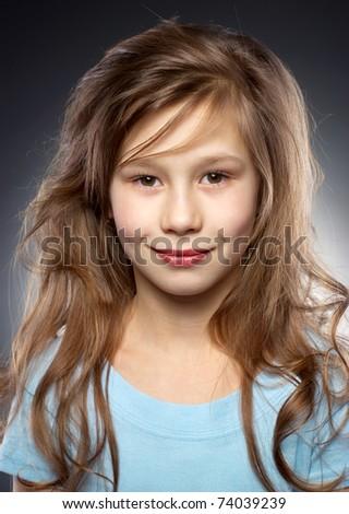 Pretty smiling girl portraite in studio - stock photo