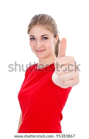Pretty smiling girl showing thumbs up - stock photo