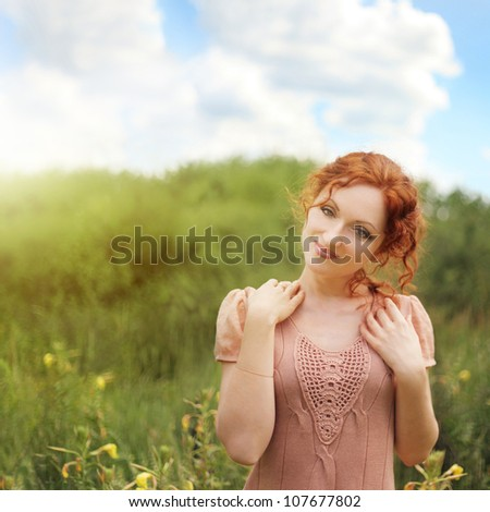 Pretty smiling red-haired woman - stock photo