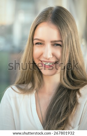 pretty smiling woman with long hair toned image