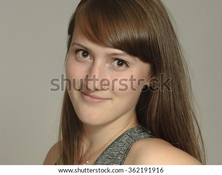 Pretty smiling young woman teenager portrait - stock photo