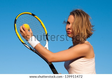 Pretty sportswoman with racket at the tennis court. Healthy lifestyle - stock photo
