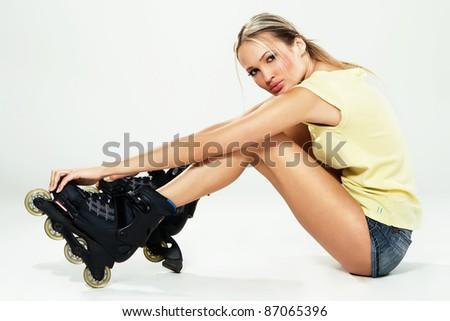 Pretty sporty girl in roller skates - stock photo