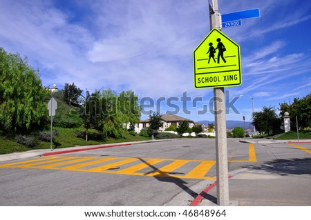 Pretty street scene of school crossing, room for your text - stock photo