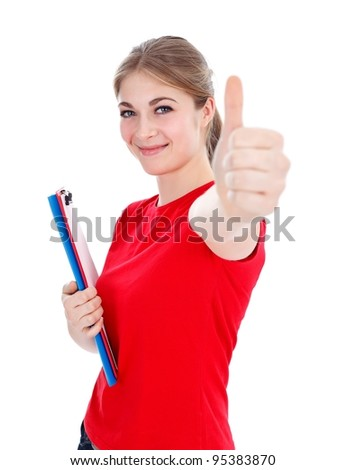 Pretty student girl showing thumbs up - stock photo