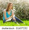 Pretty student studying outdoors - stock photo