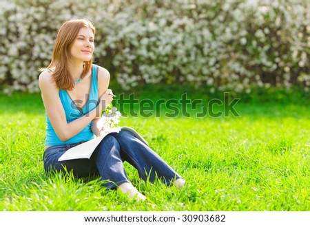 Pretty student studying outdoors