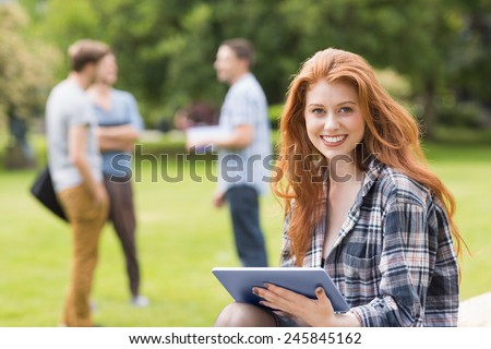 Pretty student studying outside on campus at the university - stock photo