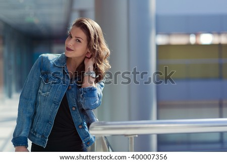 Pretty stylish woman walking in a shopping mall