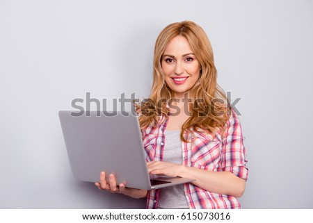 Pretty stylish young woman using the laptop