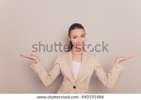 Pretty successful businesswoman gesturing with hands and showing balance - stock photo