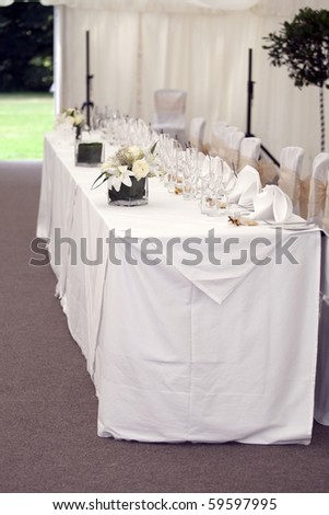 pretty table setting in a marquee - stock photo