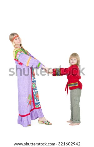 pretty teen girl and little boy wearing russian folk clothes