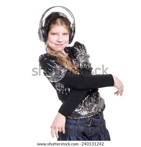 pretty teen girl in headphones dancing in studio - stock photo