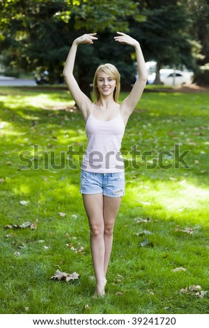 Pretty Teen Girl in Park Doing a Ballet Pose
