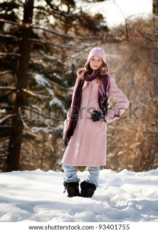 pretty teen girl outdoors in winter
