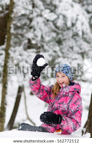 pretty teen girl playing out in a beautiful snowy forest - stock photo