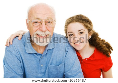 Pretty teen girl spending time with her handsome grandfather.  Isolated on white. - stock photo
