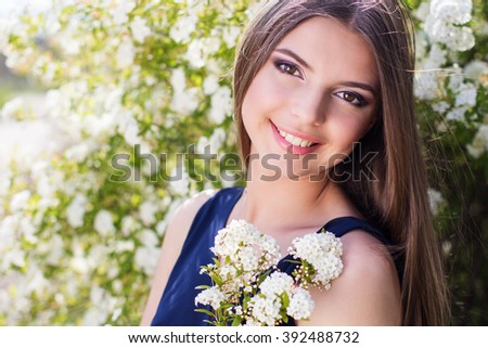 Pretty teen girl with white flowers - stock photo