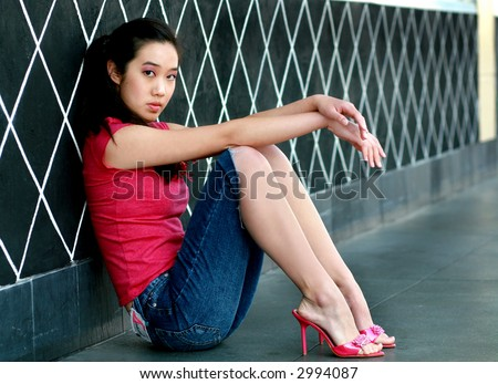 Pretty teen in heels - stock photo