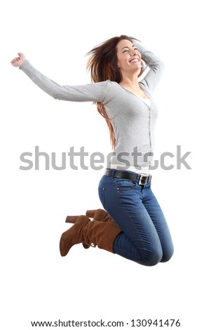 Pretty teen jumping happy with her arms raised on a white isolated background