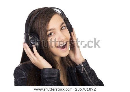 Pretty teenage girl  listening music on her headphones and singing isolated on white background - stock photo