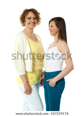 Pretty teenage girl looking at her modern mum. All on white background